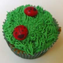Ladybugs on grass cupcake